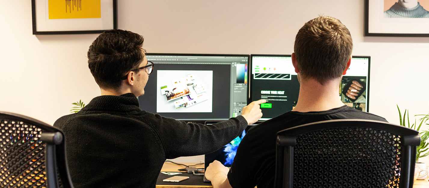 Two of our developers looking ad websites we have designed